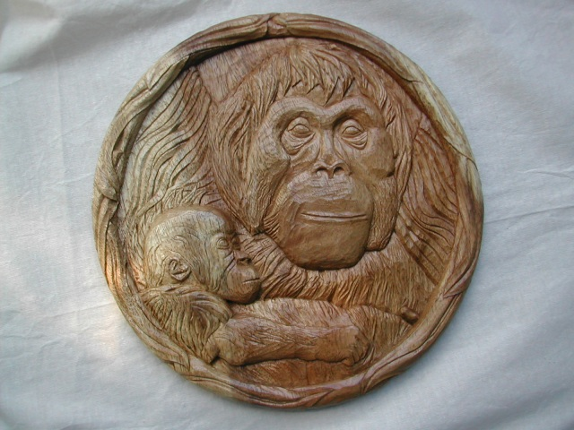 "bas relief carved in walnut, the wood being 3/4"" thick, the circle being 10"" diameter"