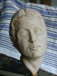 allegorical portrait in clay